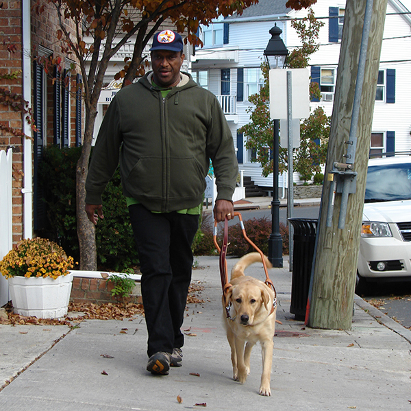 Paul trains with his guide dog in Port Jefferson, New York