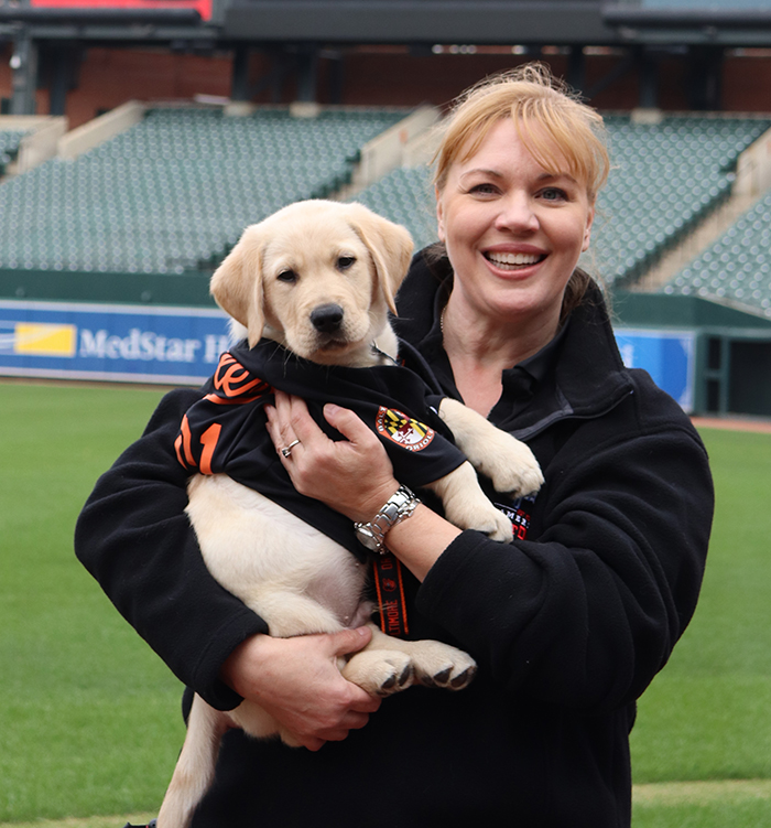 Holly holding Brooks at Camden Yards.